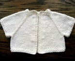 Handknit ivory wool shrug with beaded detail