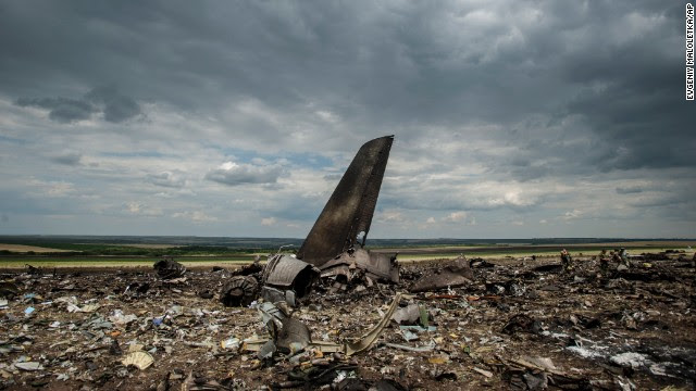 Debris lies scattered at an airport in Luhansk, Ukraine, on Saturday, June 14, after the crash of a Ukrainian Ilyushin-76 military transport plane. A military spokesman said the aircraft was shot down by pro-Russian separatists, killing all 49 aboard. Here's a look at images from the upheaval that has persisted in eastern Ukraine after the election of President Petro Poroshenko.