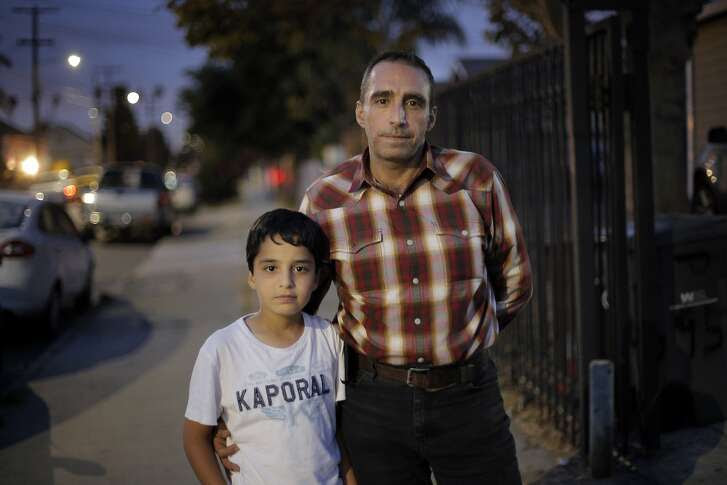 Mohammed Rawas escaped from Syria with his wife and four children, and after some time moving around the middle east, have settled into a home in Oakland, Calif. He is seen here with his sone Mohamed, 10, in their neighborhood on Tuesday, September 15, 2015.
