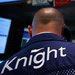 Traders from Knight Capital watched the firm's chief executive, Thomas Joyce, give a television interview from  the floor of the New York Stock Exchange on Thursday.