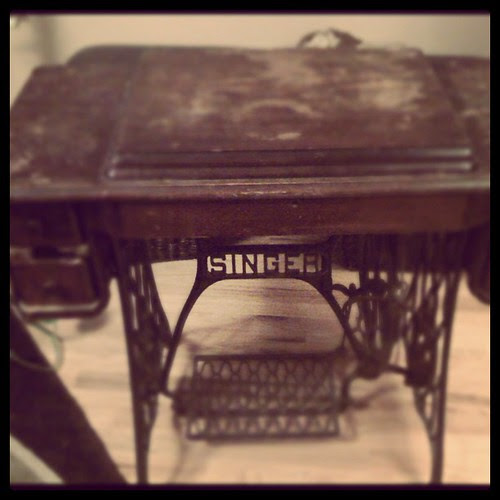 I picked up Great-grandma Nelson's antique treadle machine today. It's seen better days, but I'm pretty excited. :-)