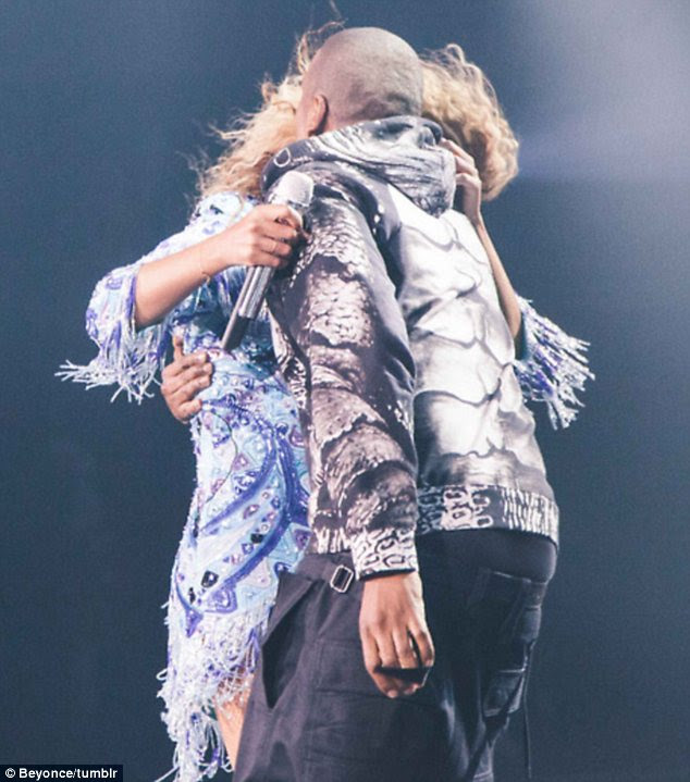 How sweet: The rapper snuck up behind his wife and then pulled her into his arms for a kiss
