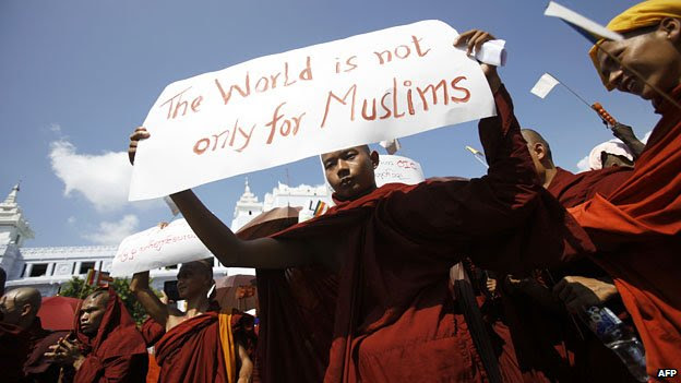 Buddhist monks take part in a demonstration against the Organisation of the Islamic Conference in Rangoon, in October 2012