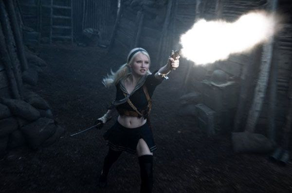 Baby Doll, played by Emily Browning, unleashes raw firepower in SUCKER PUNCH.