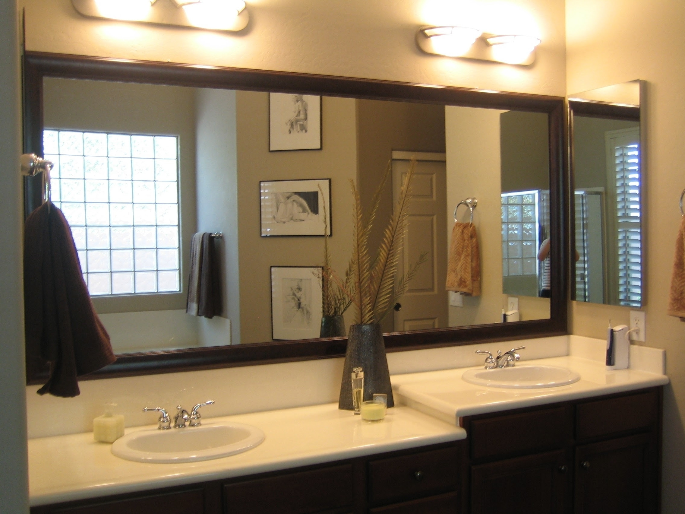Bathroom mirrors - separate or one big piece of glass ...