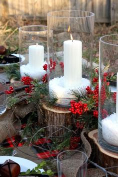 A Natural Christmas Tablescape.  Dollar store candles and cylinders, epson salt as snow, greens and berry picks, twigs and cut wood blocks, add some burlap.