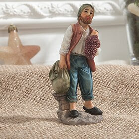 Figura de pastor con saco de fruta de 10,5cm