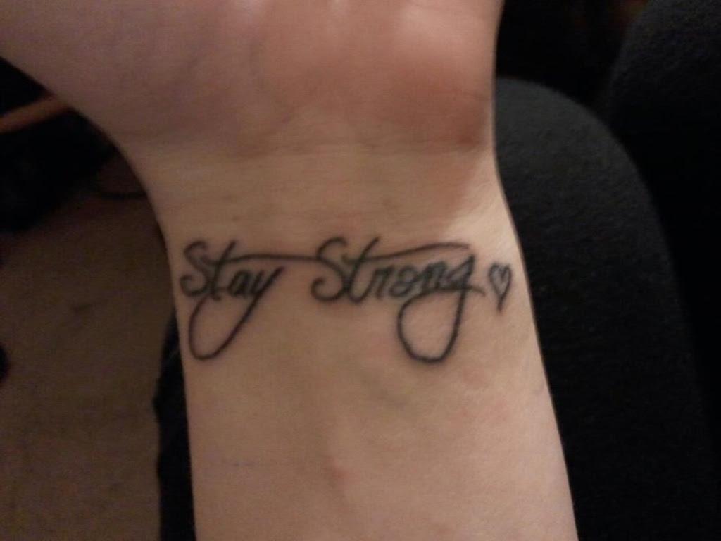 55 Attractive Wording Tattoo On Wrists