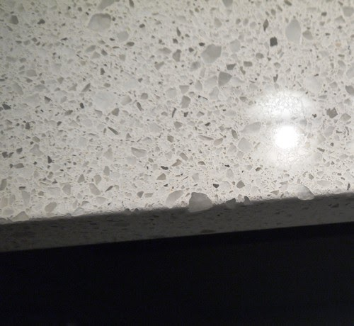 Nesting in the rain the kitchen the countertop controversy for How much is a slab of quartz