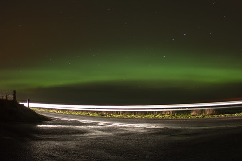 Cars going past the Northern Lights