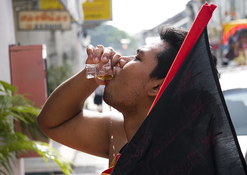 Ma Song takes a drink
