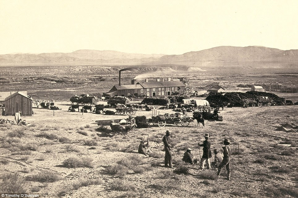 19th century housing: Members of Clarence King's Fortieth Parallel Survey team explore the land near Oreana, Nevada, in 1867