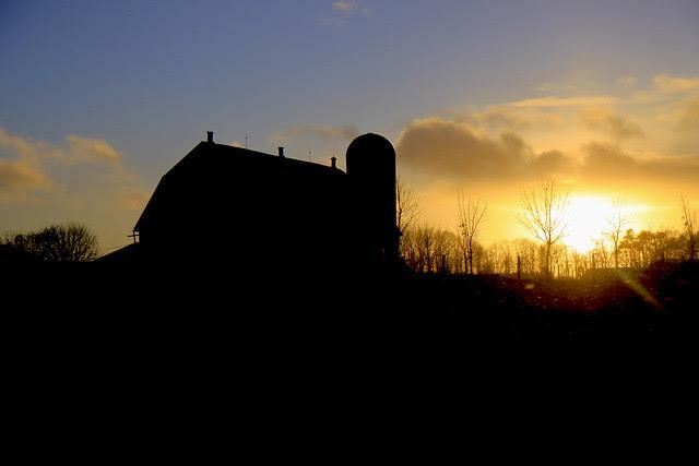 drive by barn setting sun