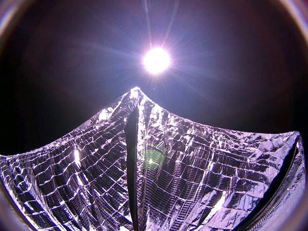 An image that was taken of the LightSail spacecraft's solar sail one day after it was successfully deployed...on June 7, 2015.