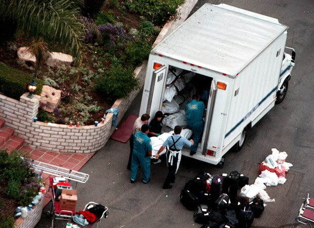 Bodies of members of the Heaven's Gate cult are loaded into a truck, 1997.