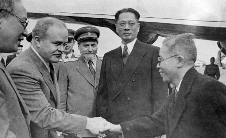 Vyacheslav Molotov welcoming a Chinese diplomat to the Soviet Union, Moscow, Russia, circa 13-14 Aug 1945; note Song Ziwen in background