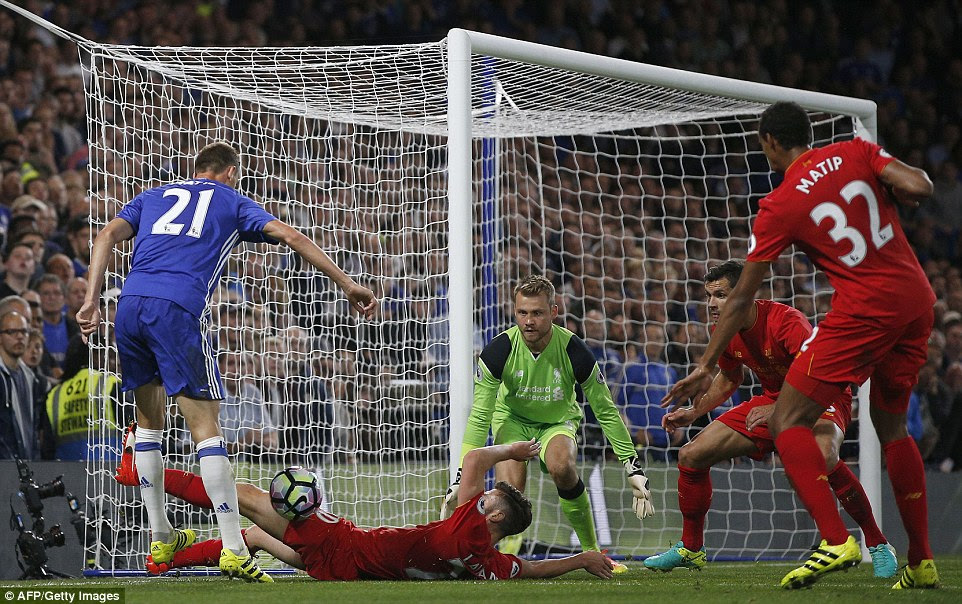 Nemanja Matic gets away a pass after a fine run to the touchline despite being surrounded by four Liverpool players