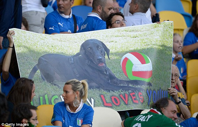 It's a dog's life! Balotelli's family were there to watch him in the stands with a banner