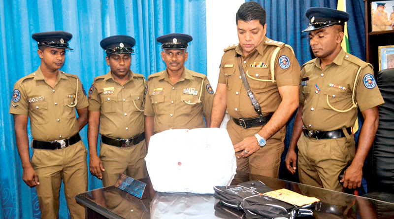 Vavuniya police inspecting the ganja haul.