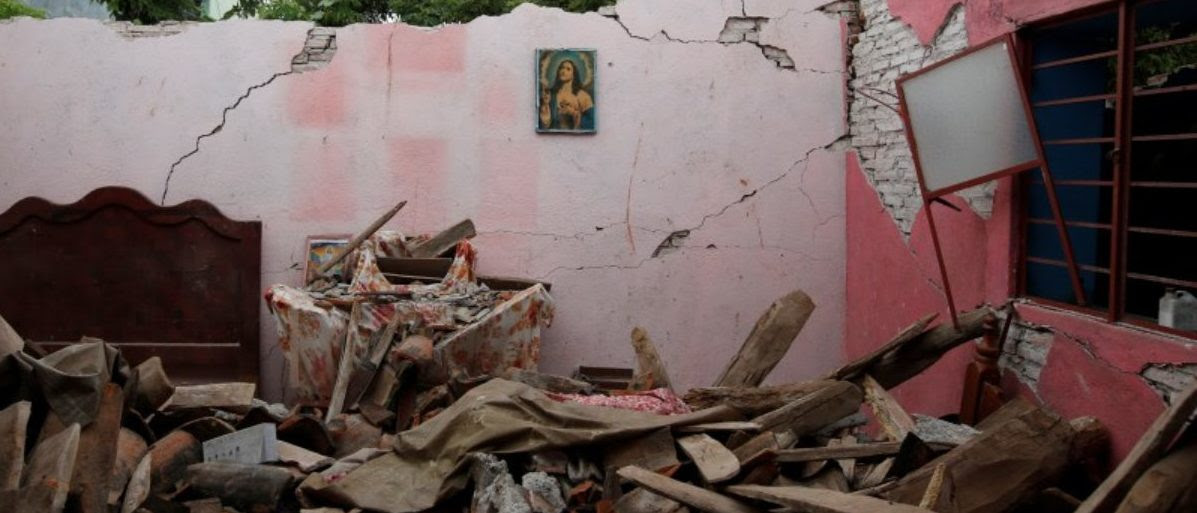An image of the Sacred Heart of Jesus is seen on the wall of a house destroyed by the earthquake that struck the southern coast of Mexico late on Thursday, in Ixtaltepec, Mexico, September 10, 2017. REUTERS/Carlos Jasso