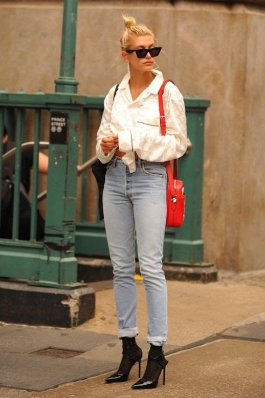 Le Fashion Blog Hailey Baldwin Sunglasses White Pajama Button Down Lightwash Jeans Black Stilletto Boots Via Harpers Bazaar