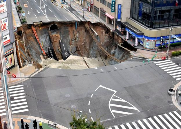 A huge sinkhole is seen at an intersection near Hakata station in Fukuoka, Japan, 8 November 2016
