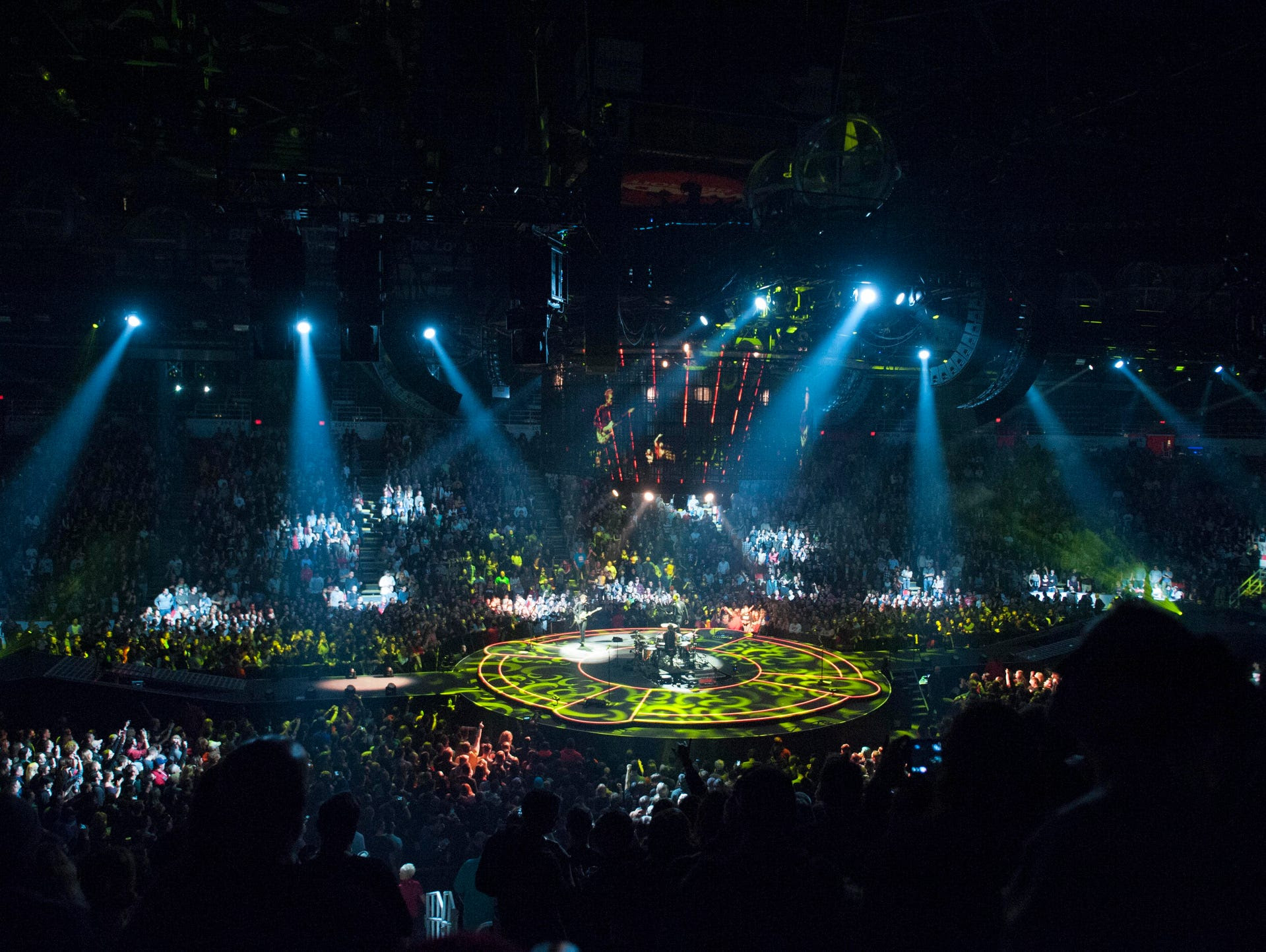Muse performs on a circular stage in the middle of