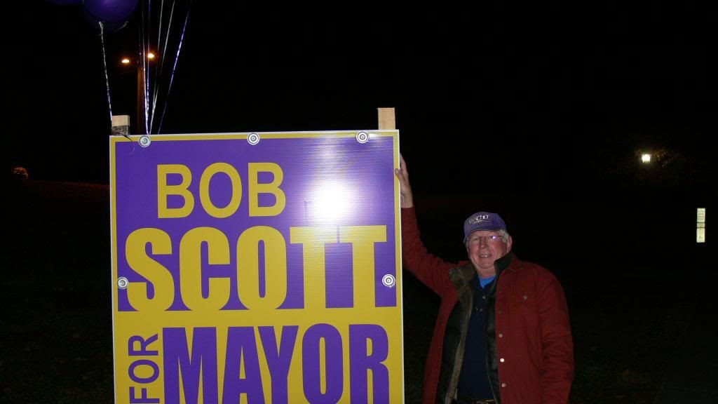Bob Scott was there early putting balloons on his sign