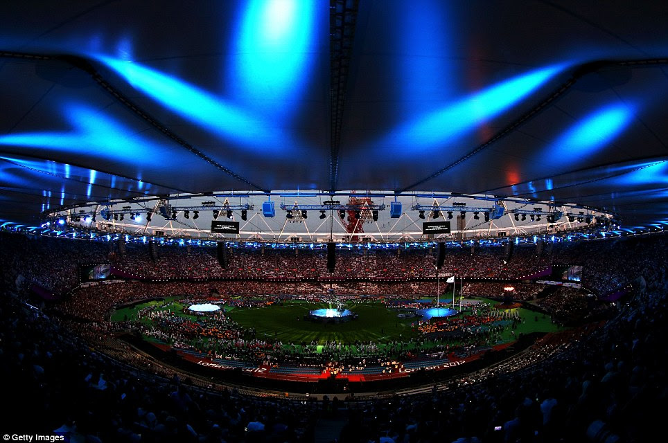 Blue wonder: The Olympic Stadium roof is illuminated by lights in the build-up to the Paralympic Closing Ceremony. The crowd of 80,000 were in their seats well before sunset in anticipation of the spectacle to come