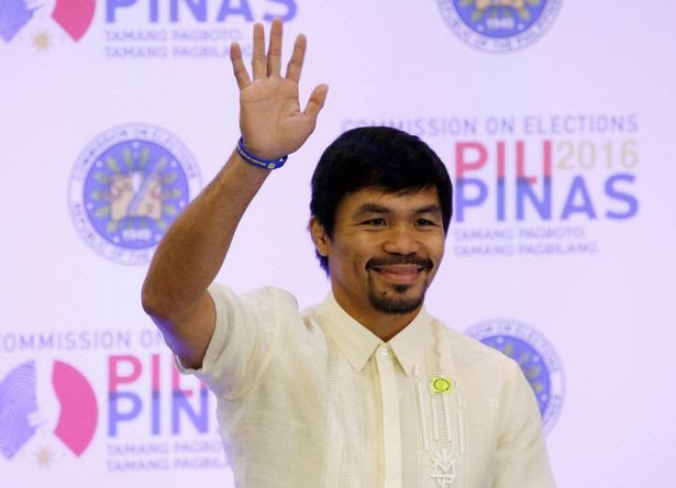 Philippine boxing star and Senator Manny Pacquiao waves to supporters after he was declared a senator by the elections commission, in Manila