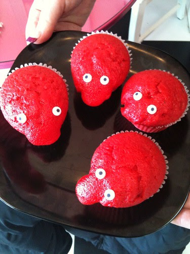 Red velvet cupcakes turned into cupcake characters at New York Cupcakes