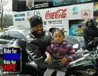 "WORLD OF SOUL MOTORCYCLE COMMUNITY RIDE FOR CHANGE Moments before the 2nd Annual Ride for CHANGE-Ride for HOPE Motorcycle Motorcade Escort supporting the PUSH Excel HBCU Tour, Greg, a Chicago area biker poses for a photograph with 3 year old Myia McLemore who penned her own slogan ""Stop the Violence-Save My Friend."" (PRNewsFoto/World of Soul Motorcycle Community) CHICAGO, IL UNITED STATES"
