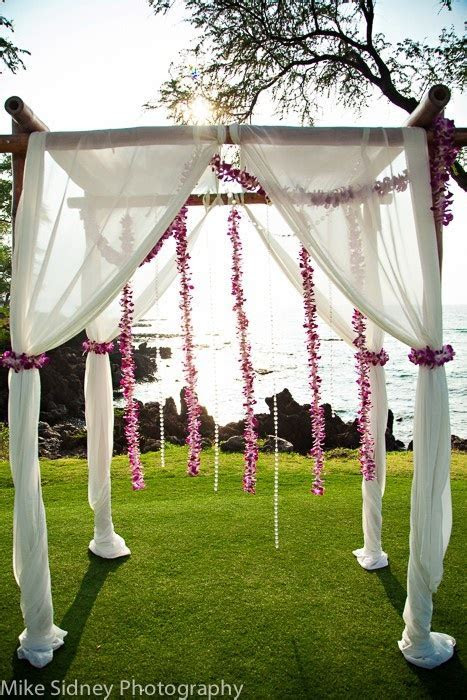 4 post bamboo arch with hanging orchid lei / www