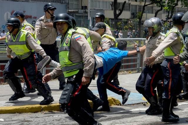 http://www.elnuevoherald.com/noticias/mundo/america-latina/venezuela-es/js2pwa/picture142640394/ALTERNATES/FREE_640/AFP_N96Z0
