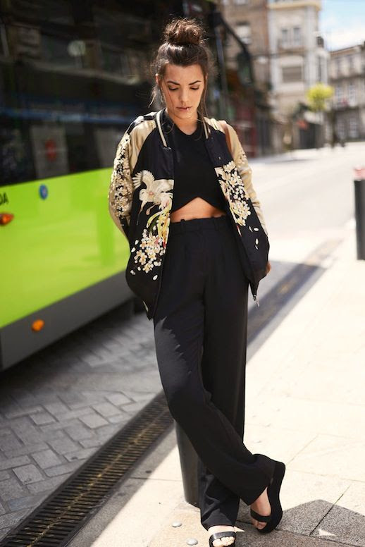 Le Fashion Blog Spring Blogger Style Top Knot Embroidered Floral Bomber Jacket Black Crop Top Brown Bag Wide Leg Pants Platform Sandals Via The Fashion Through My Eyes