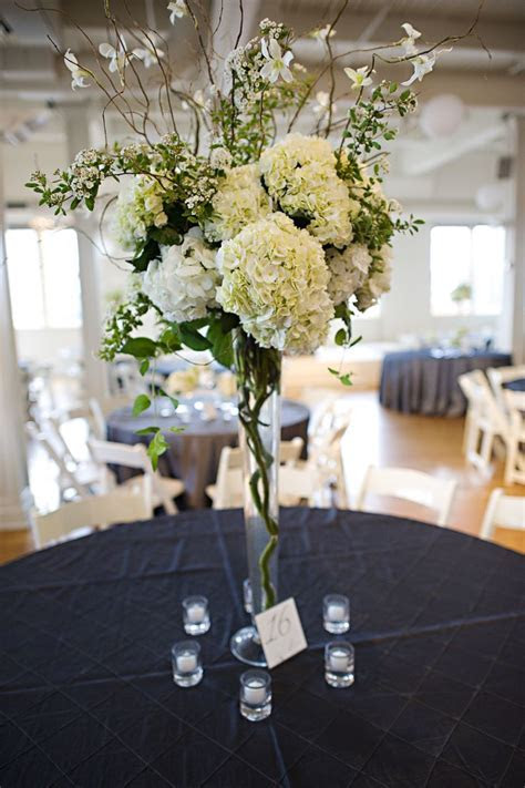 dried curly willow branches with hydrangeas in tall vase