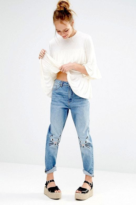 Le Fashion Blog Summer Style Top Knot White Blouse Slouchy Embroidered Jeans With Kitty Faces Black Espadrille Wedge Sandals Via ASOS