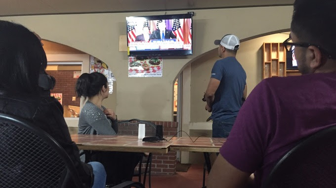 Hispanic residents watch the vote