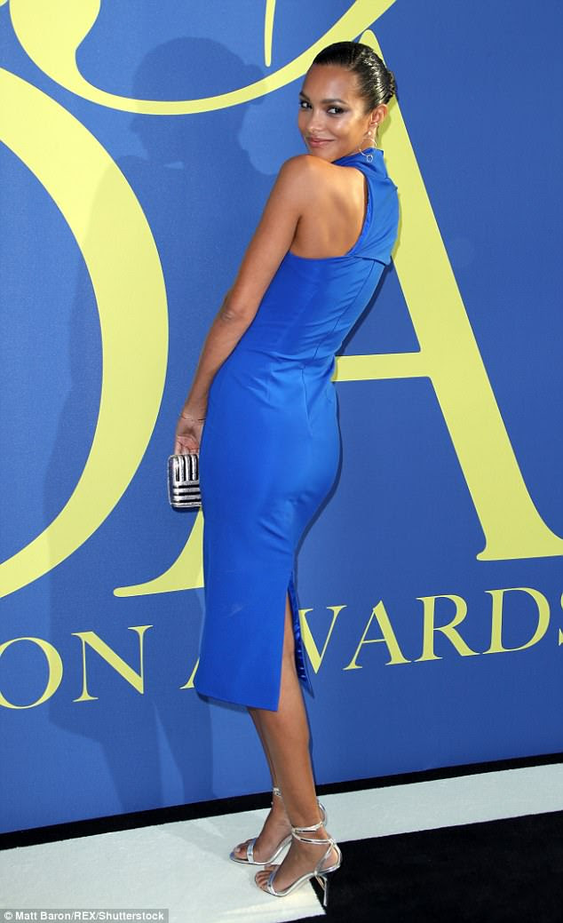 Strike a pose: Lais paired her vibrant ensemble with silver heels and Mateo earrings