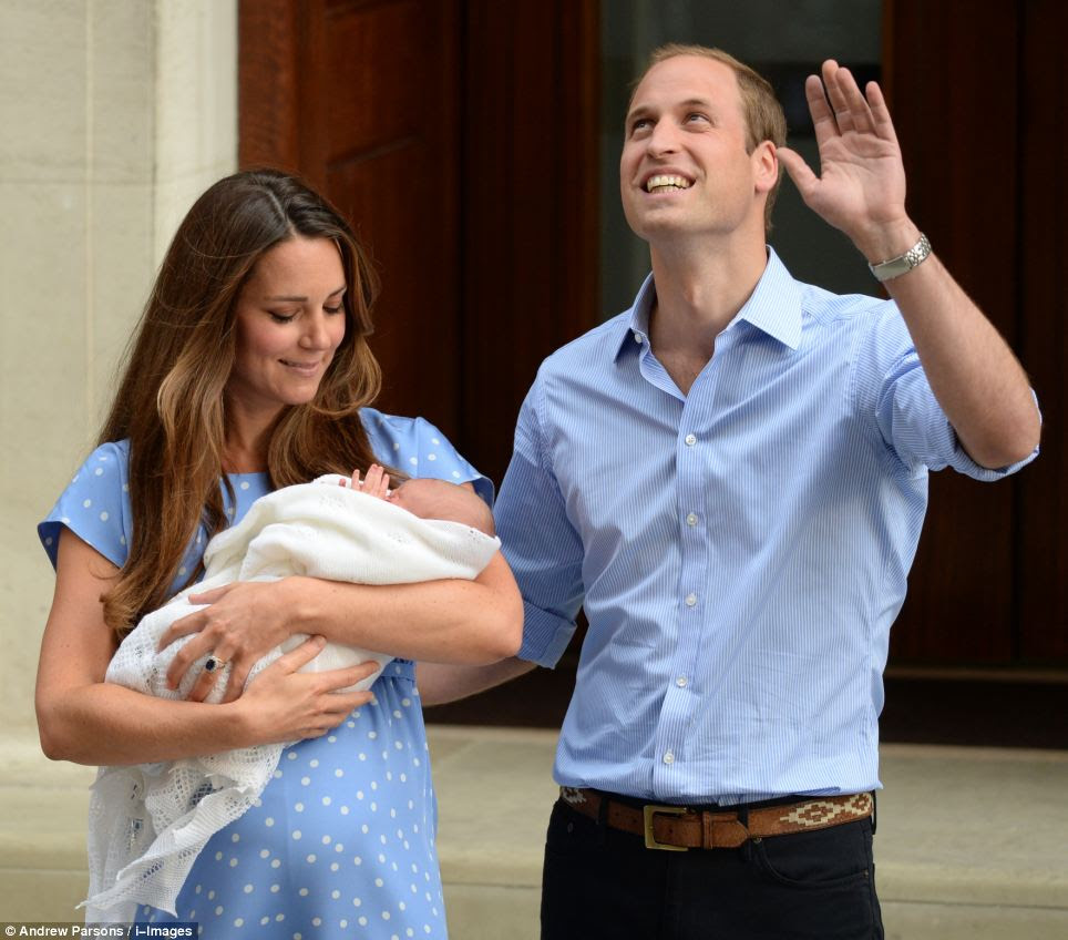 Emotional: The new mother looked delighted as she looked down at her first child while her husband waved to the excited crowds