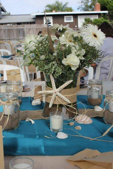 Beach themed centerpiece for a wedding   Celebrate