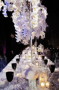 Black goblets accented the white and silver tables. Click to see more photos from this real wedding.