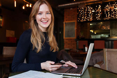 Businesswoman working on a side hustle