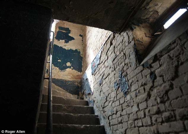 Eroded: Rainwater has stripped away most of the buildings' paintwork and detailing