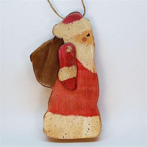 primitive Santa wooden Christmas ornament movable arm