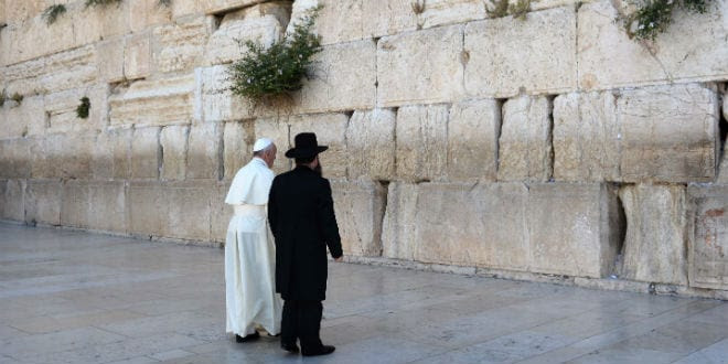 Rabbi of the Western Wall, Rabbi Shmuel Rabinovitch, accompanies Pope Francis, during a visit at the Western Wall, Judaism's holiest site, in Jerusalem's Old City, on May 26, 2014. (Photo: Kobi Gideon/GPO/FLASH90)