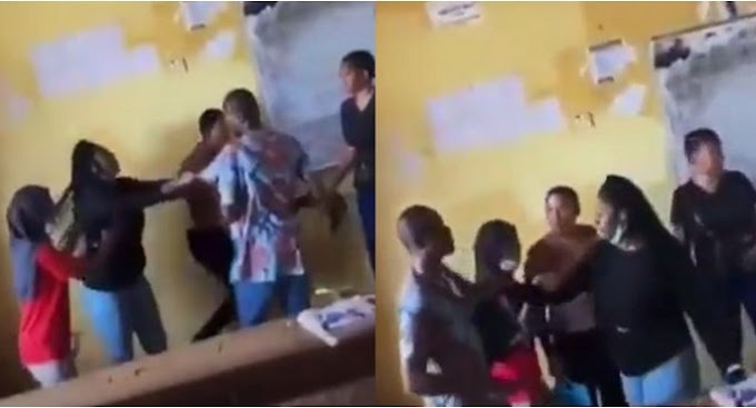 Female student fights her lecturer and tears his shirt for not allowing her write an exam (Video)
