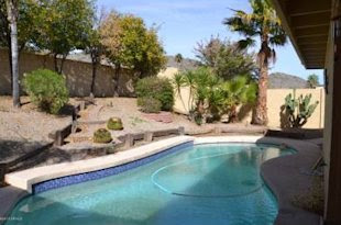 A 3-bedroom, 2-bath Phoenix home for sale at $210,000, just about the market median. Click the photo to go to the listing.
