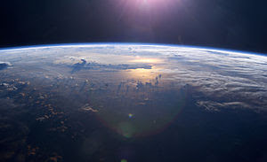 This view of Earth's horizon as the sun sets o...