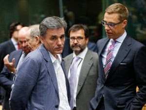 Eurogroup Finance ministers meeting<br>epa04843524 Greek Finance Minister Euclid Tsakalotos (L) and Finnish Finance Minister Alexander Stubb talk at the start of a special Eurogroup finance ministers meeting on the Greek crisis, at the European Council headquarters in Brussels, Belgium, 12 July 2015. Eurozone Finance Ministers set 12 July 2015 as the deadline to reach an agreement saving Greece from bankruptcy, amid warnings that failure to strike a deal by then could lead the country to crash out of the eurozone. EPA/OLIVIER HOSLET